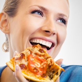 womanlaughingeatingpizza